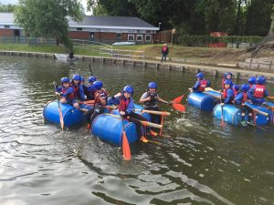Cubs using the raft they built.